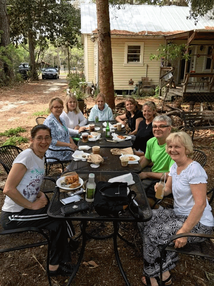 Happy people having lunch during Meridian Massage in-person classes.